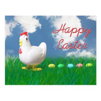 Pascua feliz con el pollo y los huevos postales