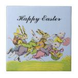 Pascua feliz que funciona con conejos en colores p azulejo ceramica