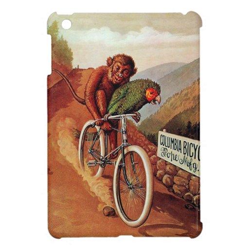 Paseo chistoso de la bicicleta del loro del mono d