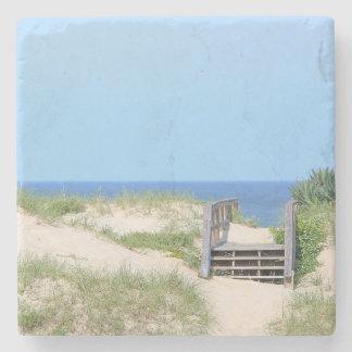 Pasos de la playa posavasos de piedra