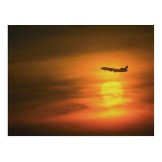 Passenger jet at sunset, on route to Frankfurt, Ge Postcard