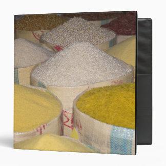 Pasta, grain and rice in sacks at the souk in 3 ring binder