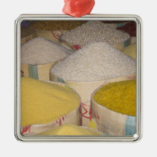 Pasta, grain and rice in sacks at the souk in metal ornament
