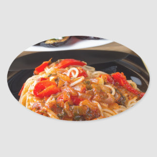 Pasta spaghetti with pieces of bell pepper oval sticker