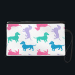 """Pastel Colored Dachshunds Wristlet<br><div class=""""desc"""">Cute pastel colored dachshund pattern.  The background color id customizable.</div>"""