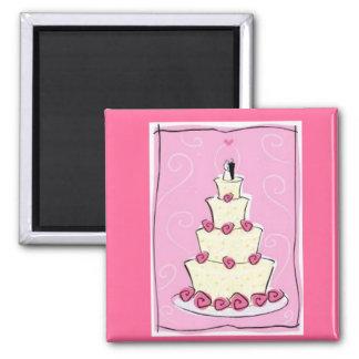 Pastel de bodas con el fondo rosado imán cuadrado