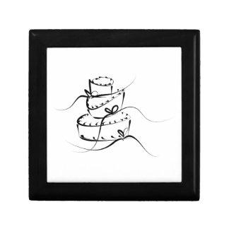 Pastel de bodas revuelto cajas de recuerdo