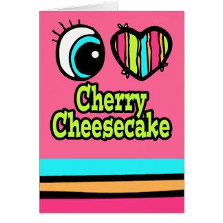 Pastel de queso brillante de la cereza del amor tarjeta de felicitación