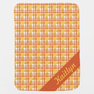 Pastel orange with yellow tartan pattern with name swaddle blanket