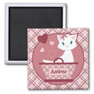 Pastel pink tartan basket with cute white kitten magnet