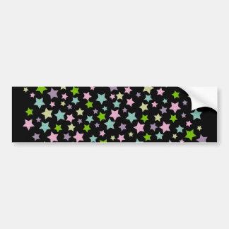 Pastel stars pattern on black bumper sticker