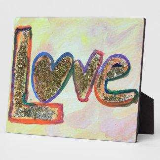 Pasteles de oro del amor que pintan la placa del