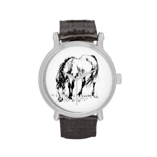 Pasto del ejemplo del caballo relojes
