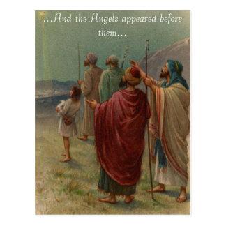 Pastores con su postal de las ovejas