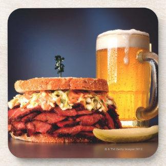 Pastrami sandwich with mug of beer coaster