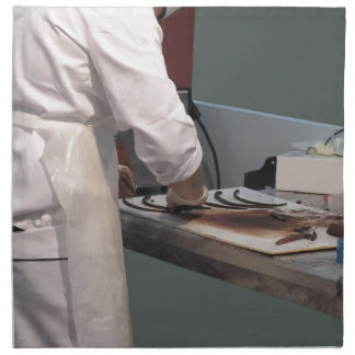 Pastry chef in the kitchen cloth napkin
