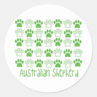Pata del pastor del australiano de la pata etiqueta redonda