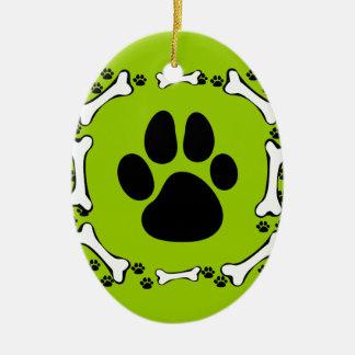 Patas del perro y huesos de perro adorno navideño ovalado de cerámica