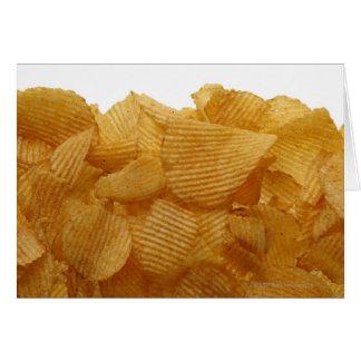 Patatas a la inglesa de patata en el fondo blanco, tarjeta de felicitación