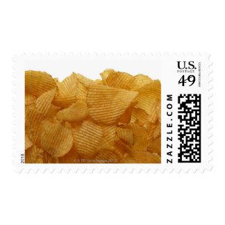 Patatas a la inglesa de patata en el fondo blanco, timbre postal