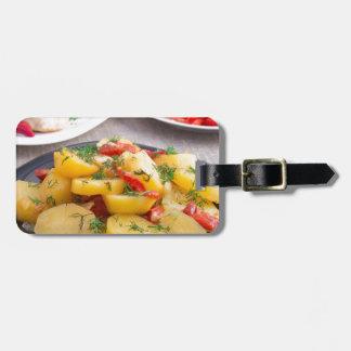 Patatas guisadas con el primer del paprika etiquetas para maletas