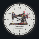 "Patchwork Quilt Sewing Machine Wall Clock<br><div class=""desc"">This sewing themed wall clock is printed with a vintage sewing machine image pieced and stitched with bright faux fabric scraps on a crisp clean black and white face. Personalize the text in the easy Zazzle editor for your favorite sewing or quilting enthusiast. Great wall decor gift for personal or...</div>"
