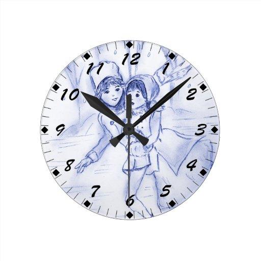 Patinadores pasados de moda en azul reloj redondo mediano