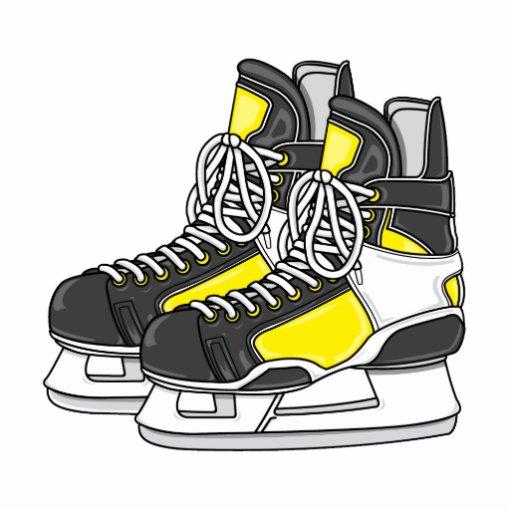 Patines amarillos del hockey sobre hielo esculturas fotográficas