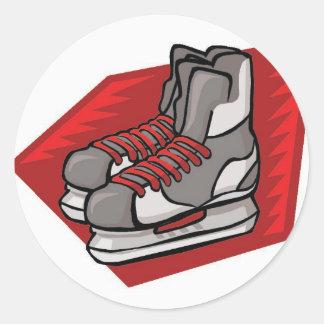 Patines del hockey sobre hielo pegatina redonda