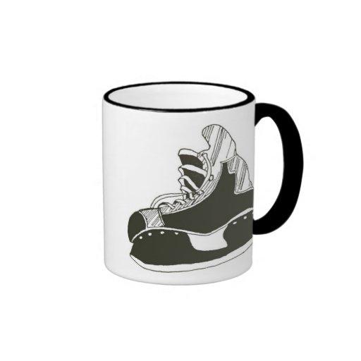 Patines del hockey taza
