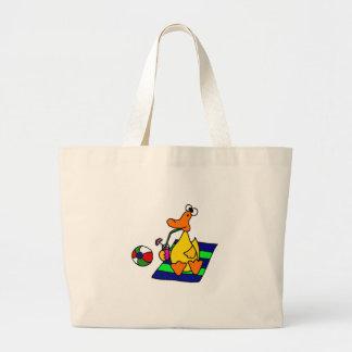 Pato amarillo divertido en la playa bolsas de mano