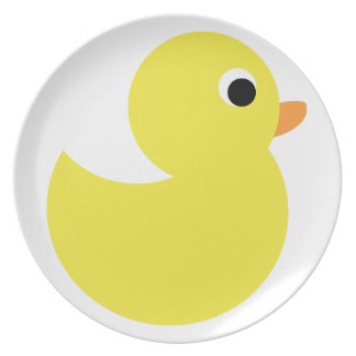 Pato de goma amarillo plato de cena