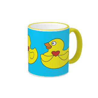 Pato de goma del dibujo animado lindo con una taza