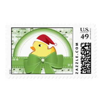 Pato de goma del navidad con franqueo verde de la estampilla