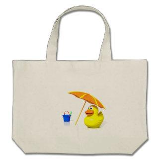 Pato de goma en la playa bolsa de mano