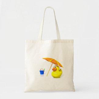 Pato de goma en la playa bolsas