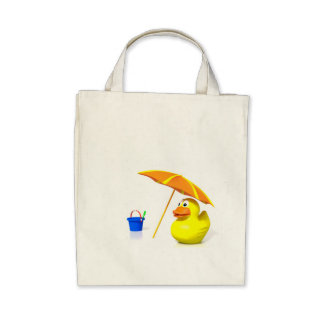 Pato de goma en la playa bolsa