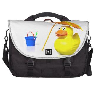 Pato de goma en la playa bolsa de ordenador
