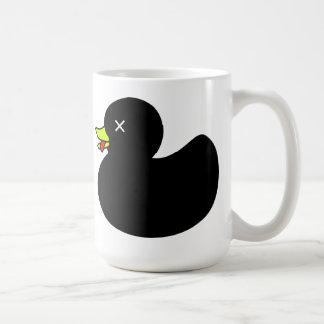 Pato de goma muerto adicional con la lengua que cu taza de café