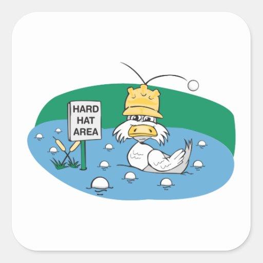 pato divertido con el casco que evita pelotas de pegatina cuadrada