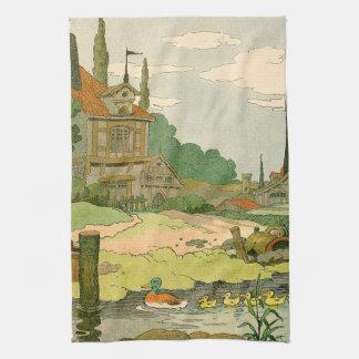 Pato salvaje y anadones que nadan en el río toallas de mano