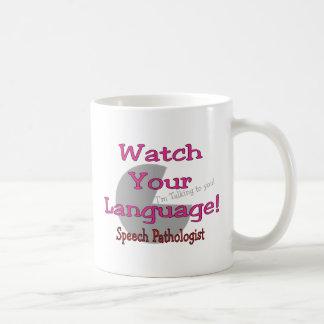 Patólogo de discurso reloj su lengua tazas