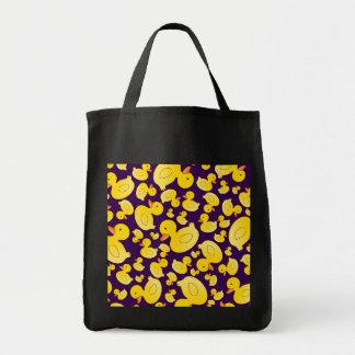Patos de goma púrpuras lindos bolsas de mano