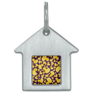 Patos de goma púrpuras lindos placa de mascota