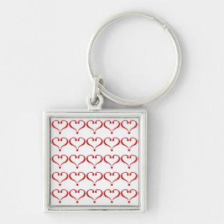 Patrón mosaico con corazones rojos fondo blanco llaveros