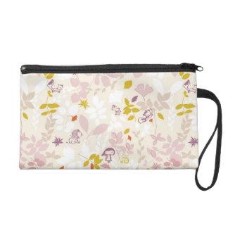 pattern displaying whimsical animals wristlet purse