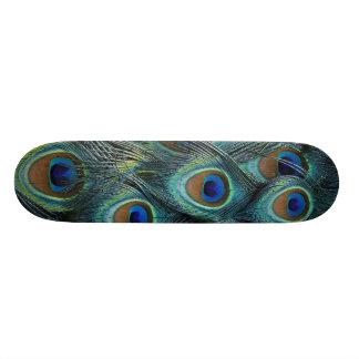 Pattern in male peacock feathers skateboard deck