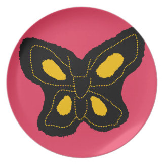 Pattern of butterfly made of cut paper party plates