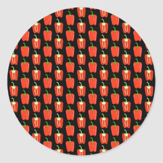 Pattern of Red Peppers, on Black. Round Sticker
