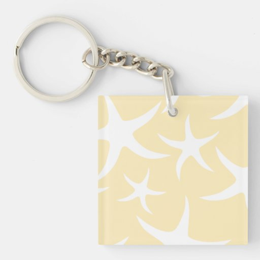 Pattern of Starfish in White and Yellow. Acrylic Keychains